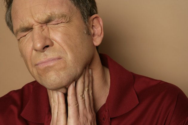 Mature man with sore throat