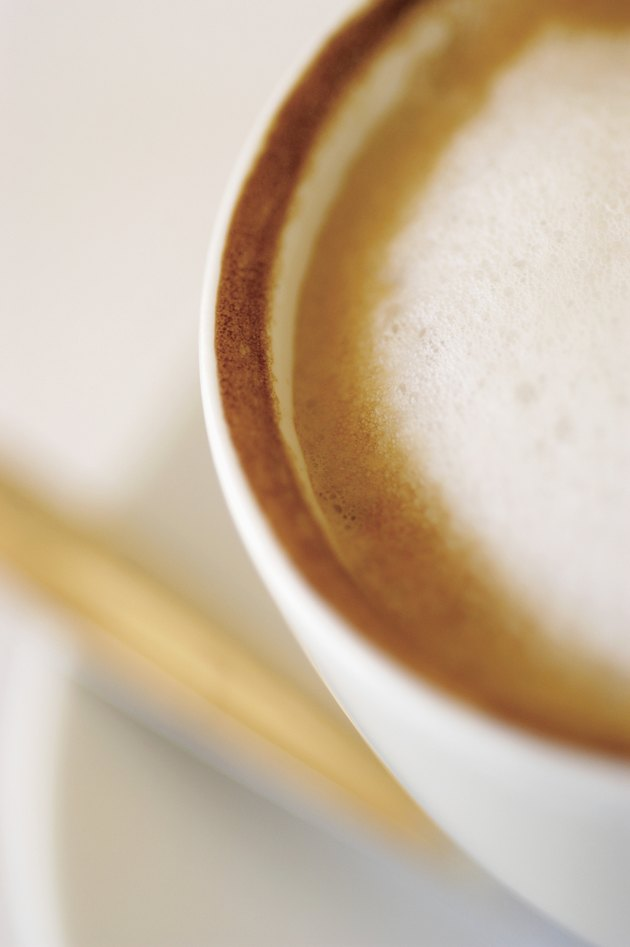 Overhead view of cappuccino in white cup