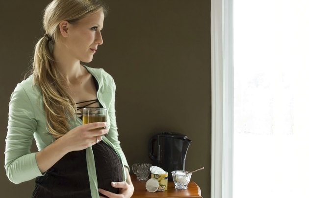 Pregnant woman with tea
