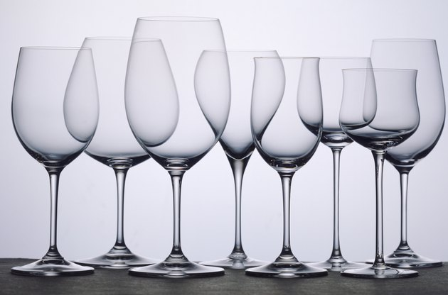 Transparent wine glasses in row, close-up