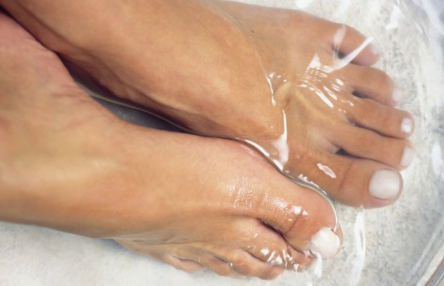 Feet soaking in water