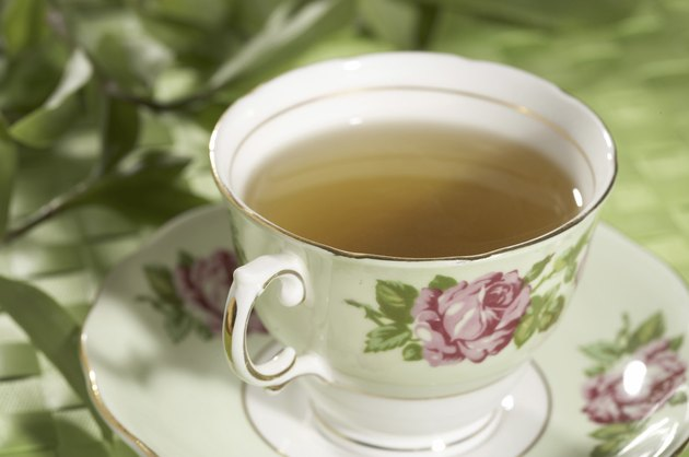 Close-up of a cup of green tea on a saucer