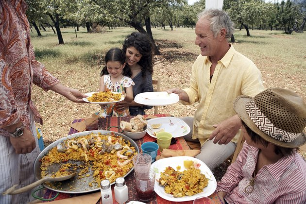 family eating paella outdoors