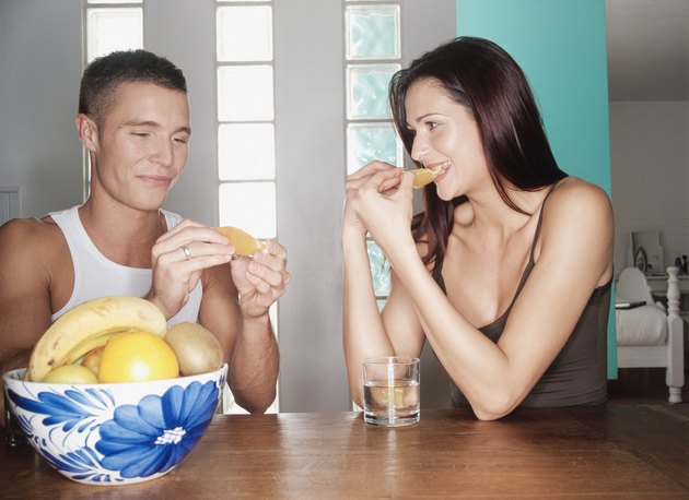 Couple eating fruit together
