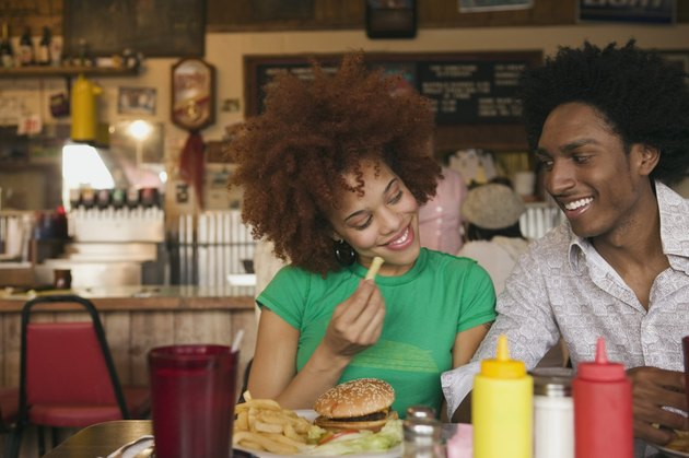 Smiling couple in diner with food
