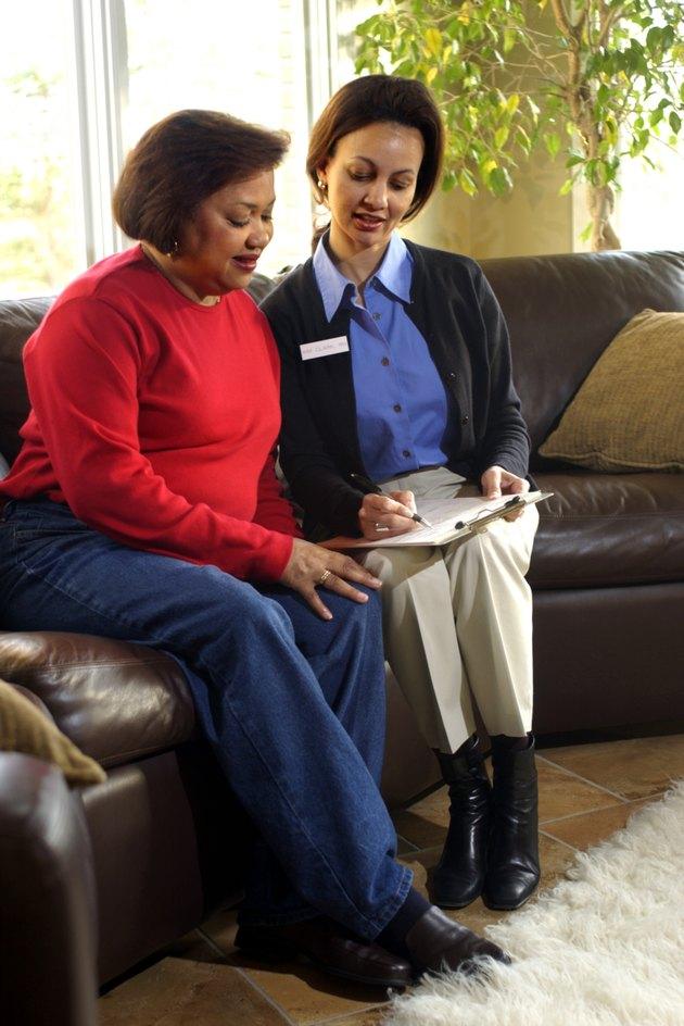 Nurse or dietician talking to patient