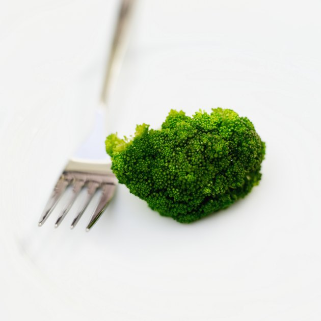 Close-up of a piece of broccoli and a fork