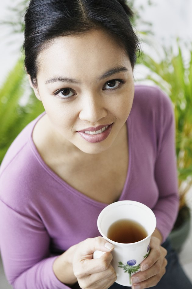 Portrait of Woman with Cup of Tea