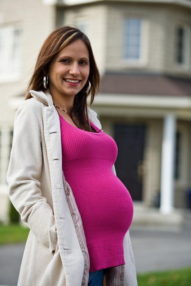 Pregnant woman smiling outdoors