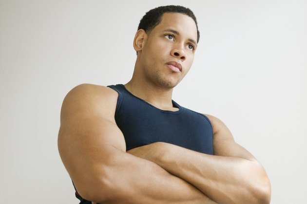 Studio shot of African American man with arms crossed