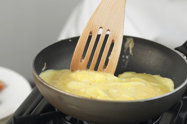 Omelette being cooked in a frying pan, close up