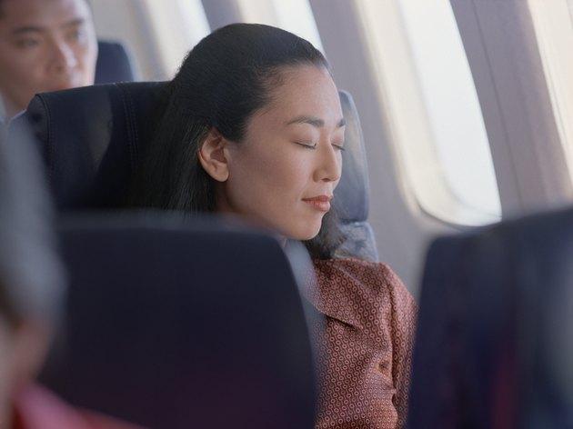 Woman sleeping in an airplane seat
