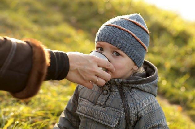 Toddler drinks tea