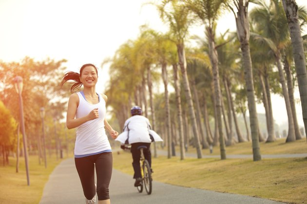 healthy lifetyle asian woman jogging at tropical park