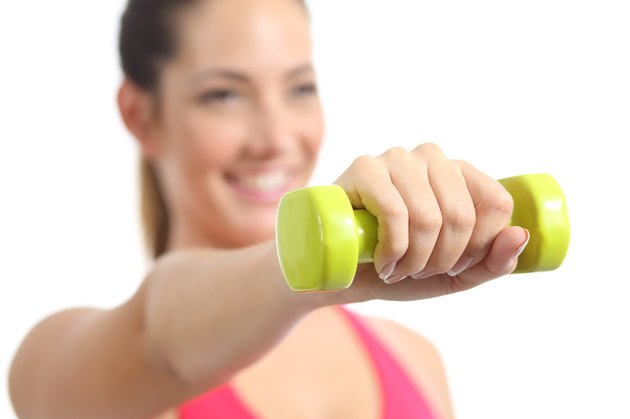 Closeup of a fitness woman exercising doing weights