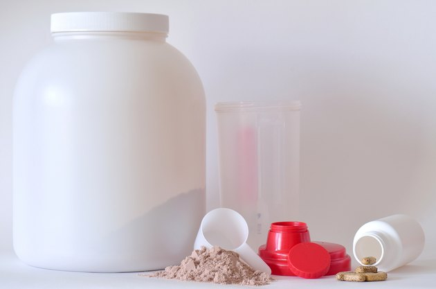 Big jar of protein powder, shaker and pills