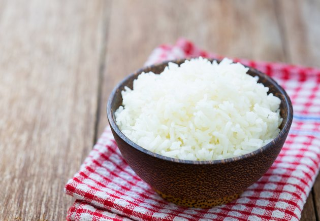 Jasmine rice in a  bowl on wood table