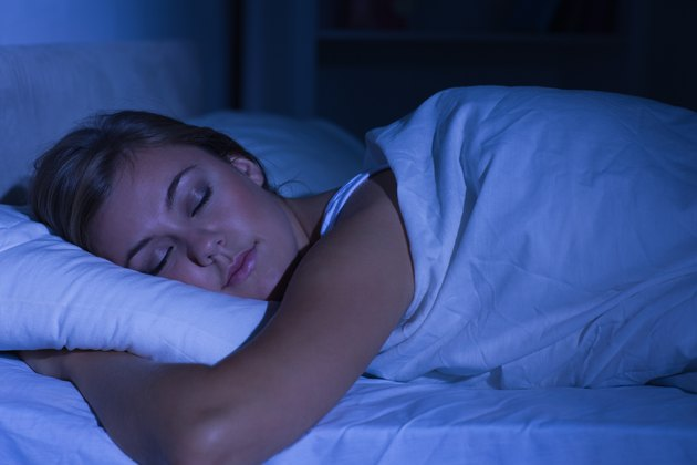 Serene woman sleeping at night