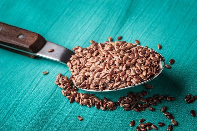 Flax seeds linseed on kitchen spoon
