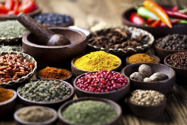 Spices on wooden bowl background
