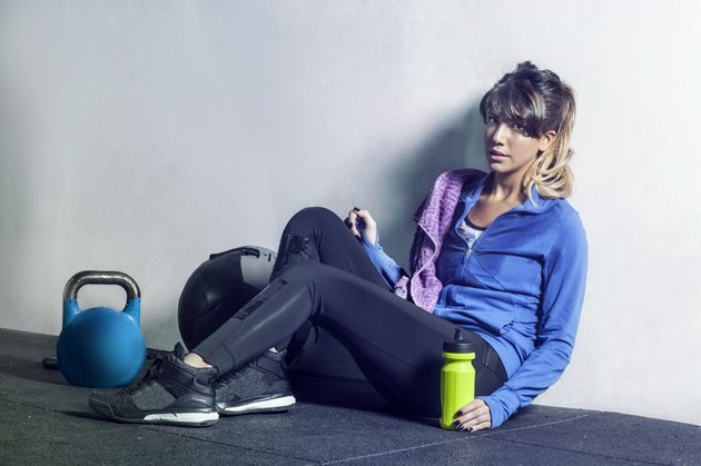 Young lady in the sports studio resting