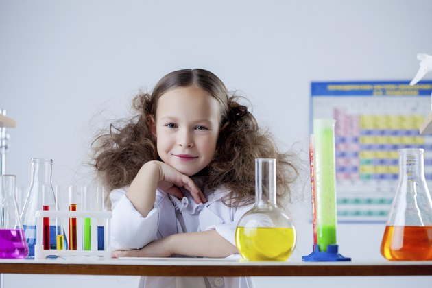 Portrait of smiling adorable girl posing in lab