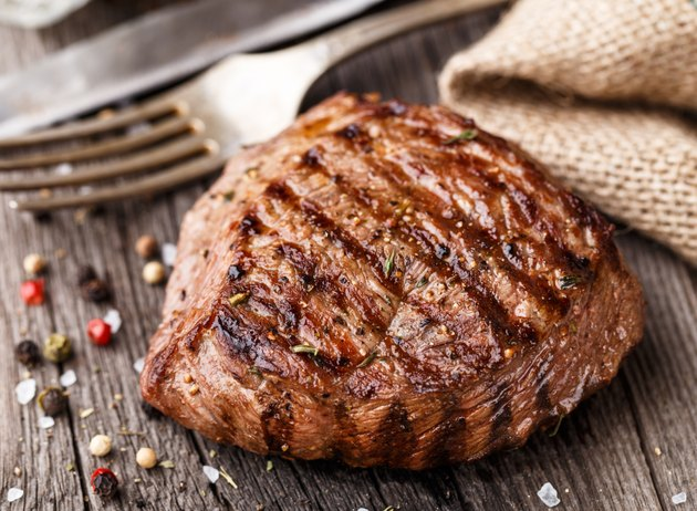 Beef steak on a wooden board