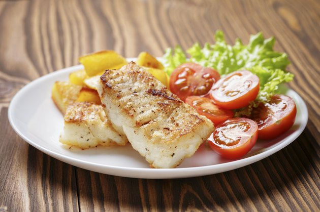 roasted codfish fillet with vegetables on ketosis diet