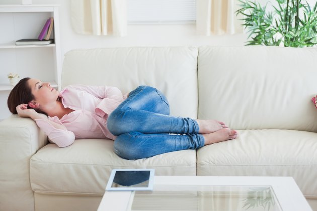 Casual woman resting on  couch at home