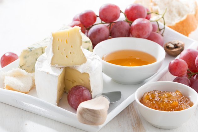 molded cheeses, fruit and snacks, closeup
