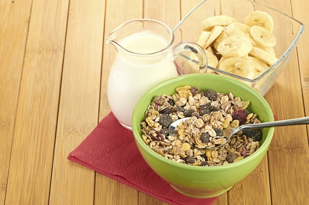 Delicious and healthy cereal in bowl with milk