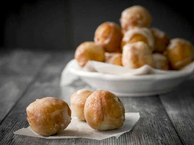 Small homemade doughnuts, also known as doughnut holes