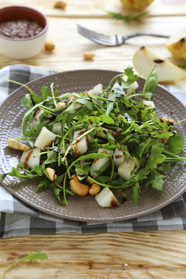 fresh salad with pear, arugula and nuts