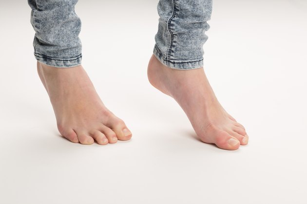 Two Bare Feet Standing TipToe On The Floor