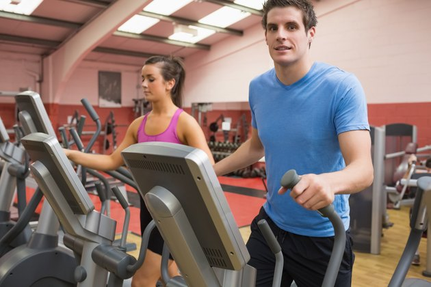 Woman and man training on a step machine