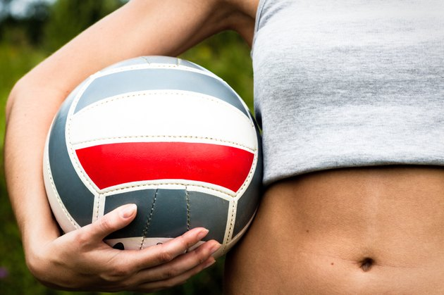 Girl hand with volleyball ball