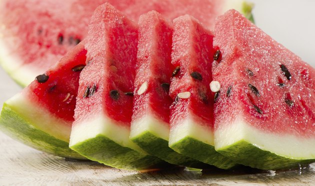 slices of watermelon on wooden table