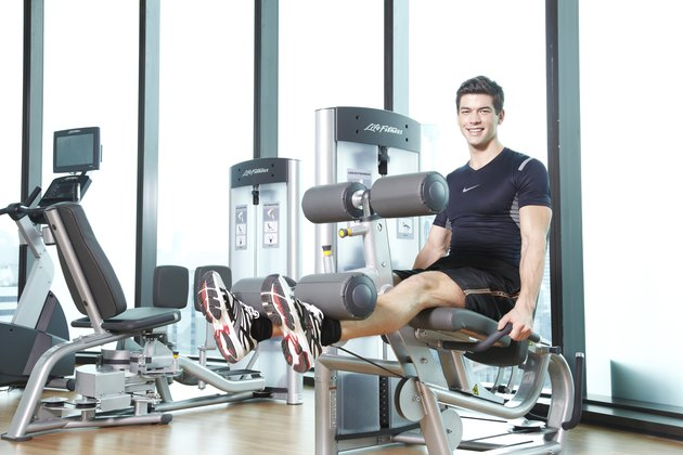man exercising on leg extension machine
