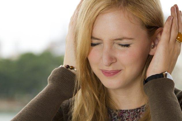 Blond Girl Covering Her Ears