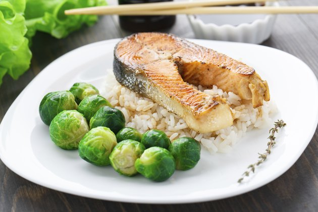 Fried salmon with rice and brussels sprouts