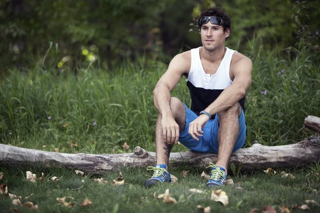 Male Athlete Resting Outside