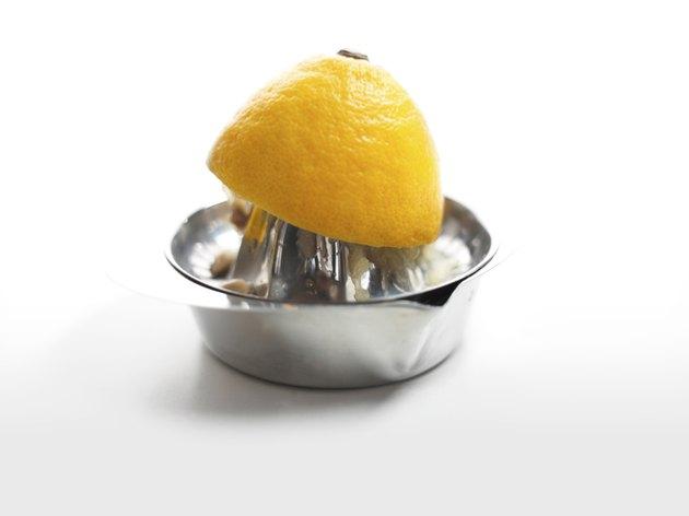 halved lemon on a squeezer
