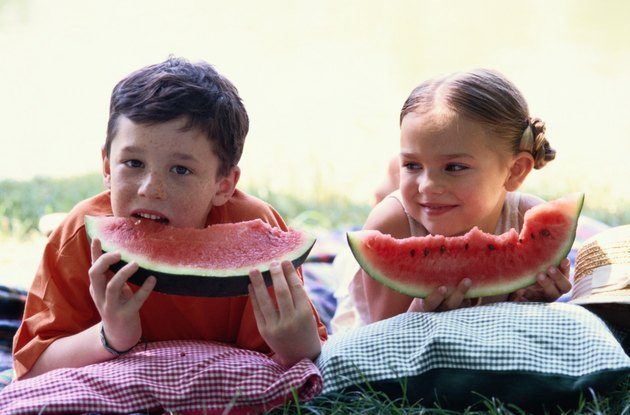 Two Young Children Eating Watermelon