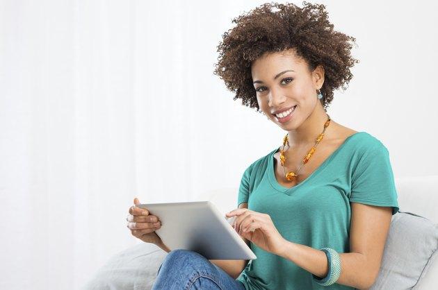 African Woman Using Digital Tablet