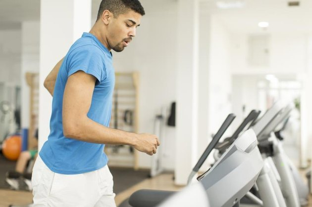 Young man training on a treadmill