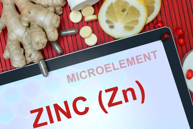 Tablet with words Zinc (Zn). microelements.