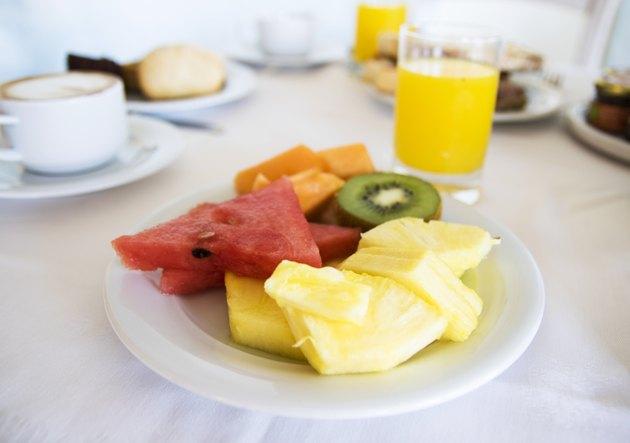 Plate of fruit and orange juice
