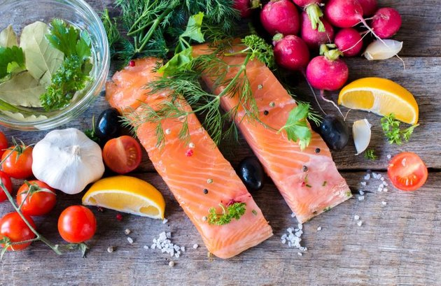 Salmon fillets on wooden background from above,selective focus