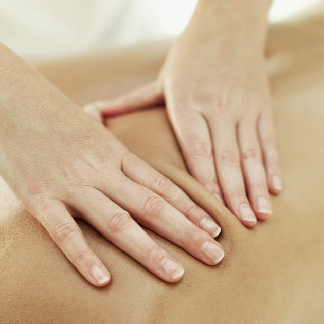 close-up of a person getting a back massage