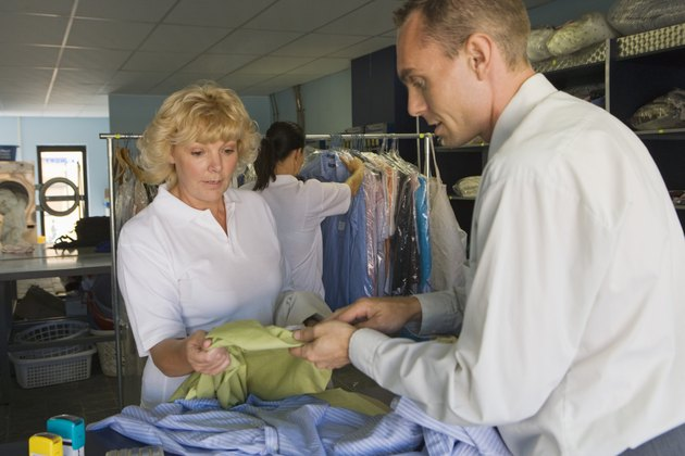 Clerk and customer at dry cleaners